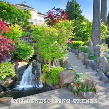 High-end home with waterfall pond and immaculate landscaping